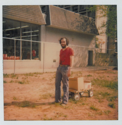 Mayer with wagon at early garden site.jpeg