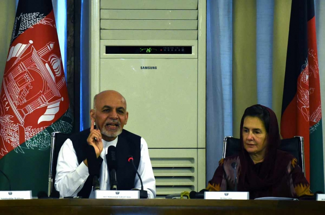 President Ashraf Ghani with his wife First Lady Rula Ghani in the Ministry of Foreign Affairs wherehe first nominated afemale judge to sit on the Supreme Court. AFP PHOTO / Wakil Kohsar
