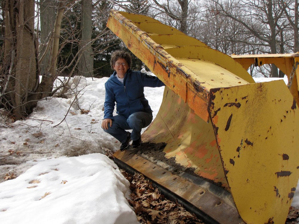 Jo Ann Butler, author and Fulton Library's Memoir Project team member, getting ready to take her ride on a snowplow.