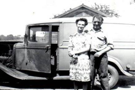 Fred Cavalier and his wife in front of the truck he used for years making ice deliveries to residents of Fulton.