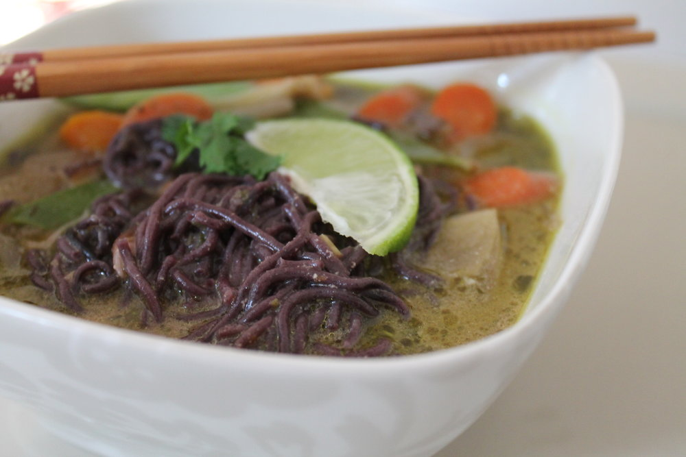 Green Curry Vegetable Soup served over forbidden black rice noodles.