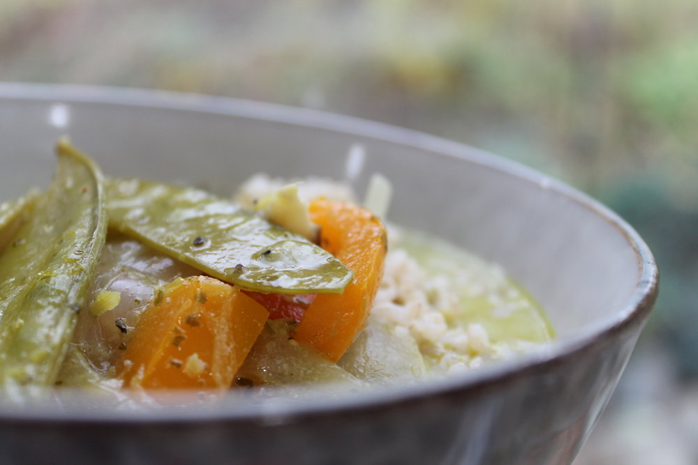 Green Curry Vegetable Soup served over cooked brown rice.