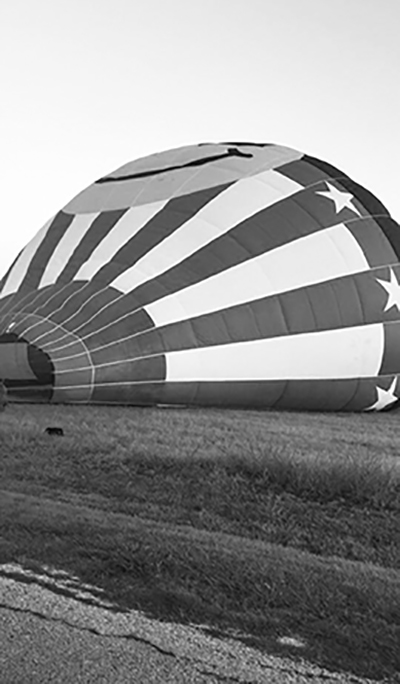 """Photo by: Lorilee Brabson, taken as they were setting up the balloon for launch. Lorilee Brabson, along with her daughter, Paige Brabson, were among the victims of the crash / Photo acquired from the Austin Monthly article """"Tragedy in Lockhart""""."""