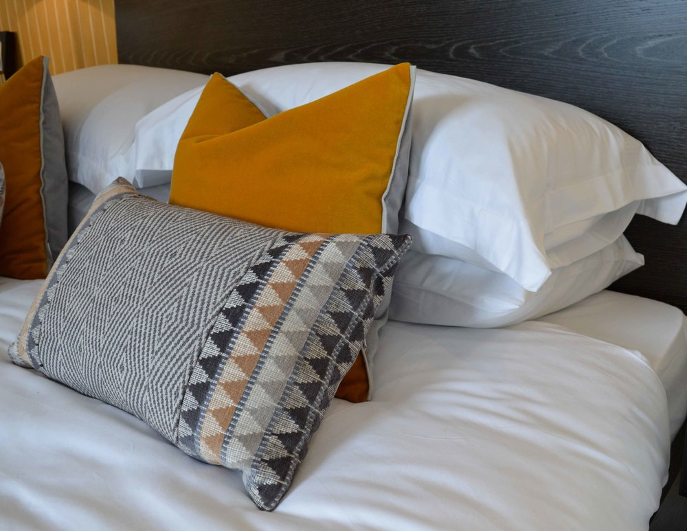 White sheets | Statement pillows with texture and quality fabric