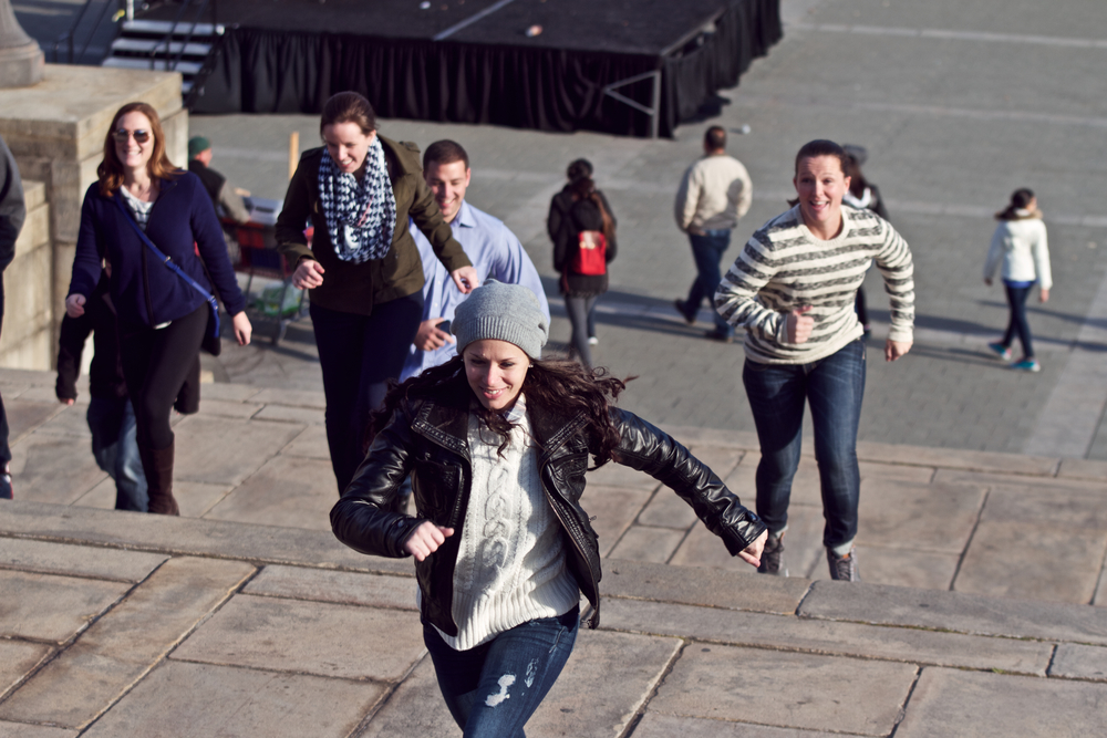 Heather and Ali race up the Art Museum steps like Rocky