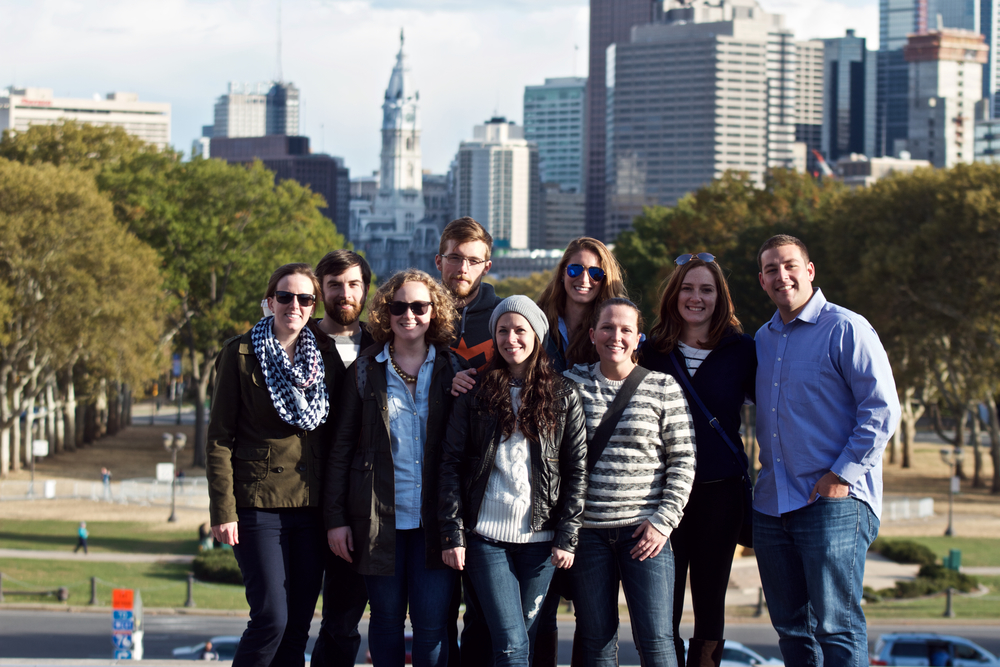 Heather, Ali and the group of friends posing at the top of the Art Museum of Philadelphia's steps