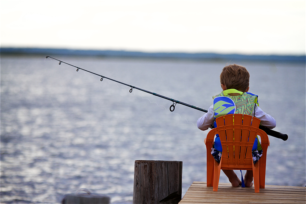 Kai here out fishing, but although his father is slightly out of the photo, I thought it captured this family the best since they love to be outdoors and active and fish.