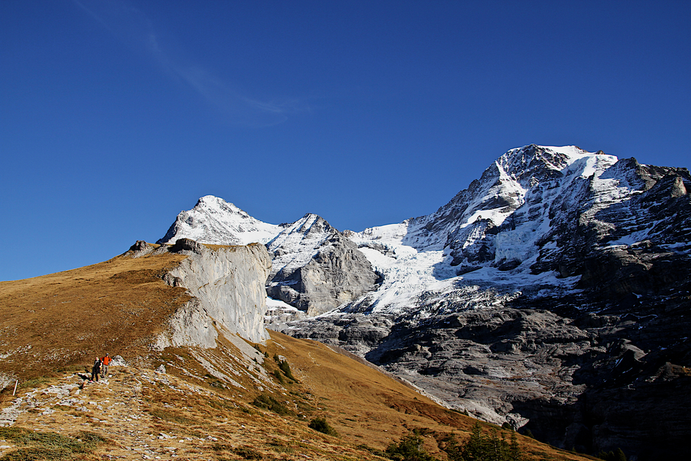 Traveling through Switzerland with a photo of the Alps