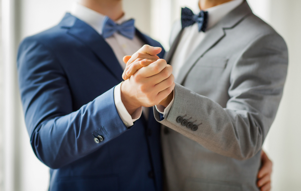 wedding-close-up-of-happy-male-gay-couple-dancing-l.jpg