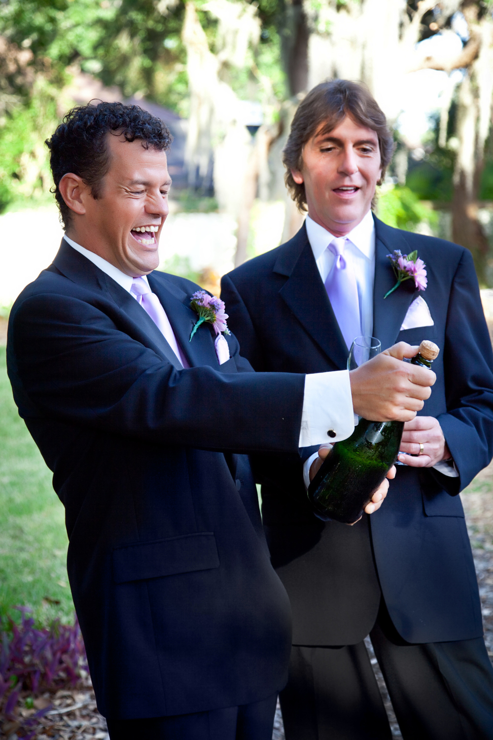 wedding-officiant-gay-couple-opening-champagne-l.jpg