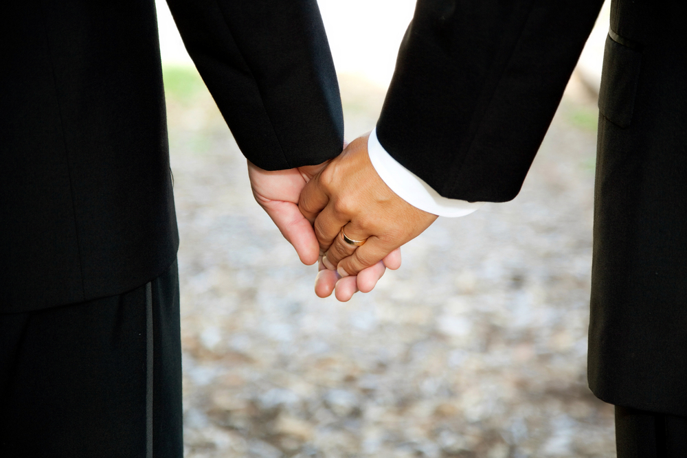 gay-officiant-gay-marriage-holding-hands-closeup-l.jpg