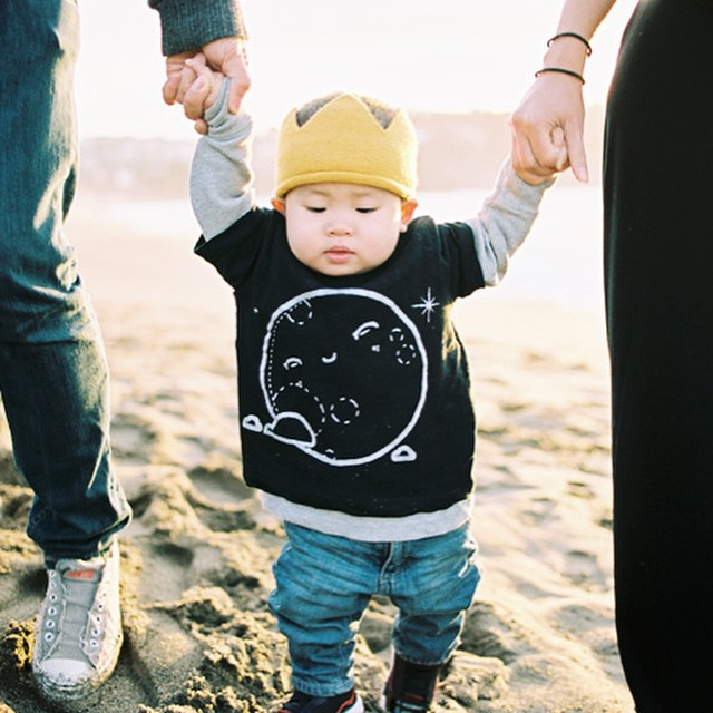 "I tend to stress out about what to dress our family in for photoshoots. So I left it up to my husband and he chose this adorable @dearest.dani tee for our little one. In the words of John Lennon, ""we all shine on like the moon and the stars and the sun."" More from our farewell shoot with @cassiegreenphotography coming soon!"
