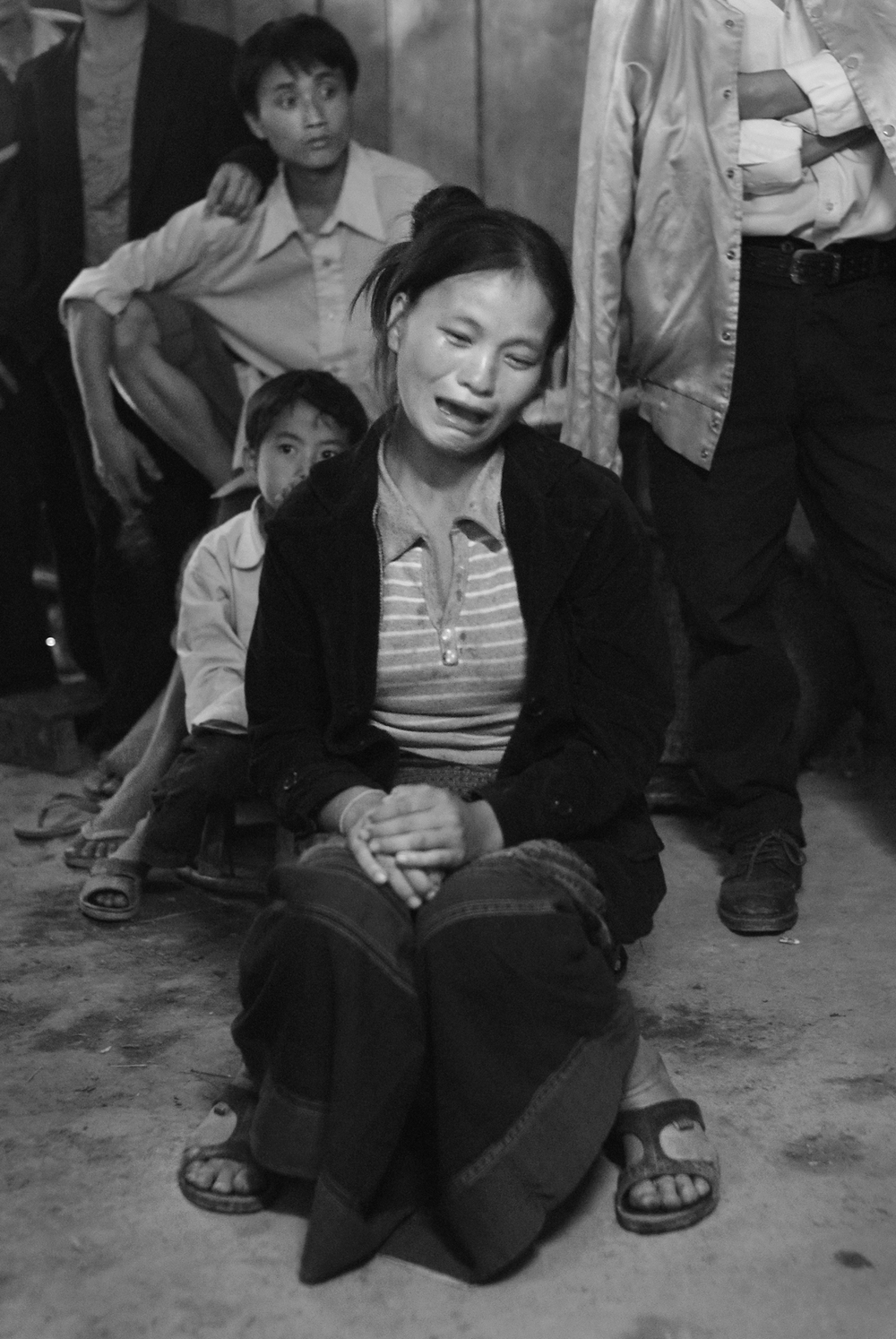 A young Hmong woman wails at the funeral for her husband who died earlier in the day in rural Xieng Khouang Province, Laos. He was killed in a family feud by a booby trap made from an unexploded bomb set in a trail. The Hmong are among the poorest of Laos' many ethnic groups.