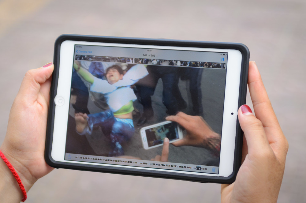 A woman reviews video of a protest by the Boeung Kak women in front of the Municipal Courthouse in Phnom Penh, Cambodia.