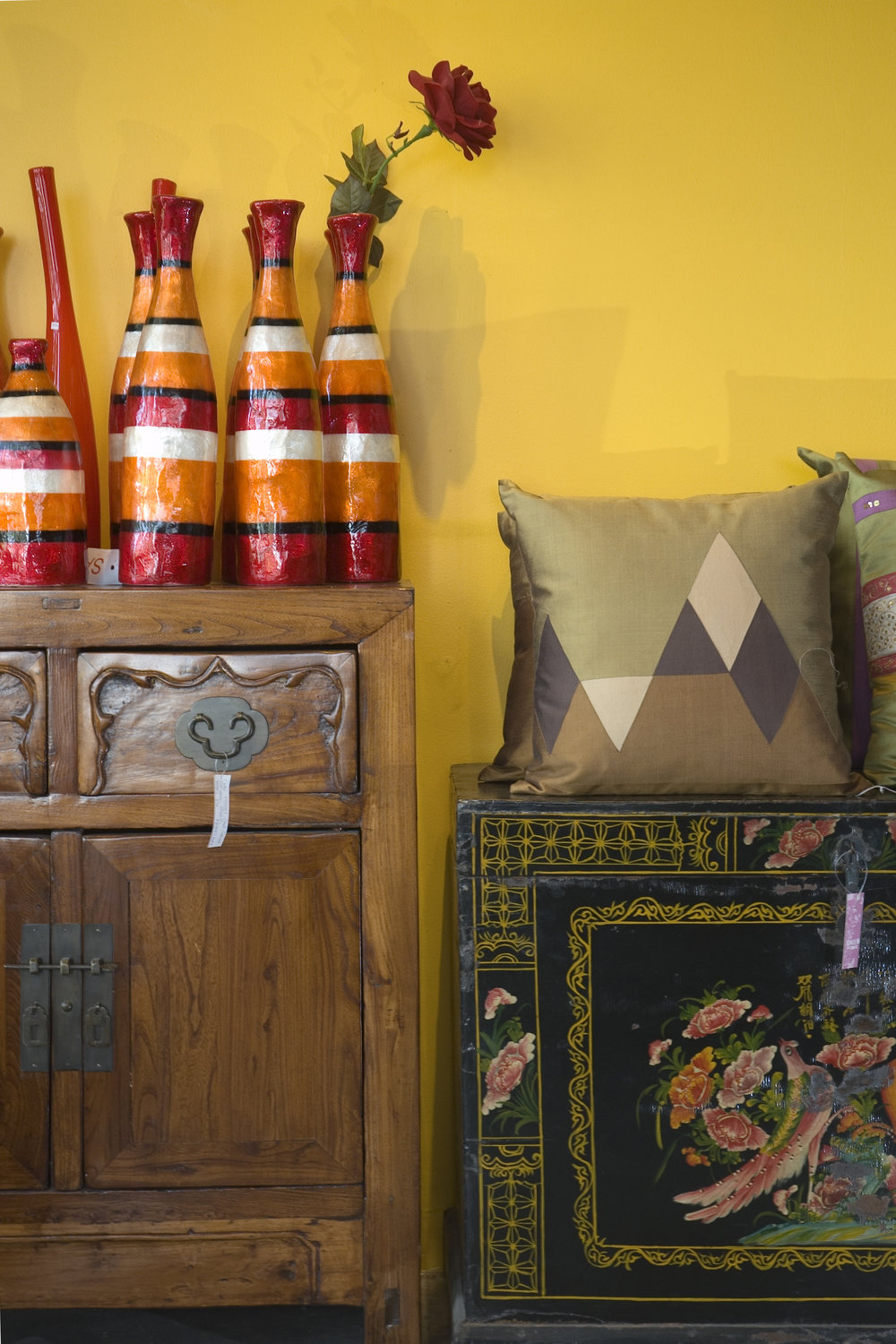 Antique Chinese cabinets are set off against very modern and playful home accessories at Ginger, a home furnishings shop best known for its eclectic mix of modern and antique styles.