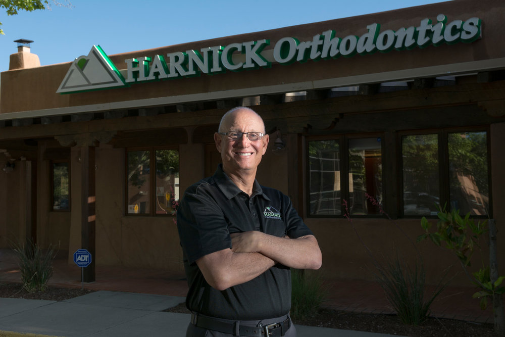 Dr. David Harnick in front of his east Albuquerque office, Harnick Orthodontics in Albuquerque, New Mexico.