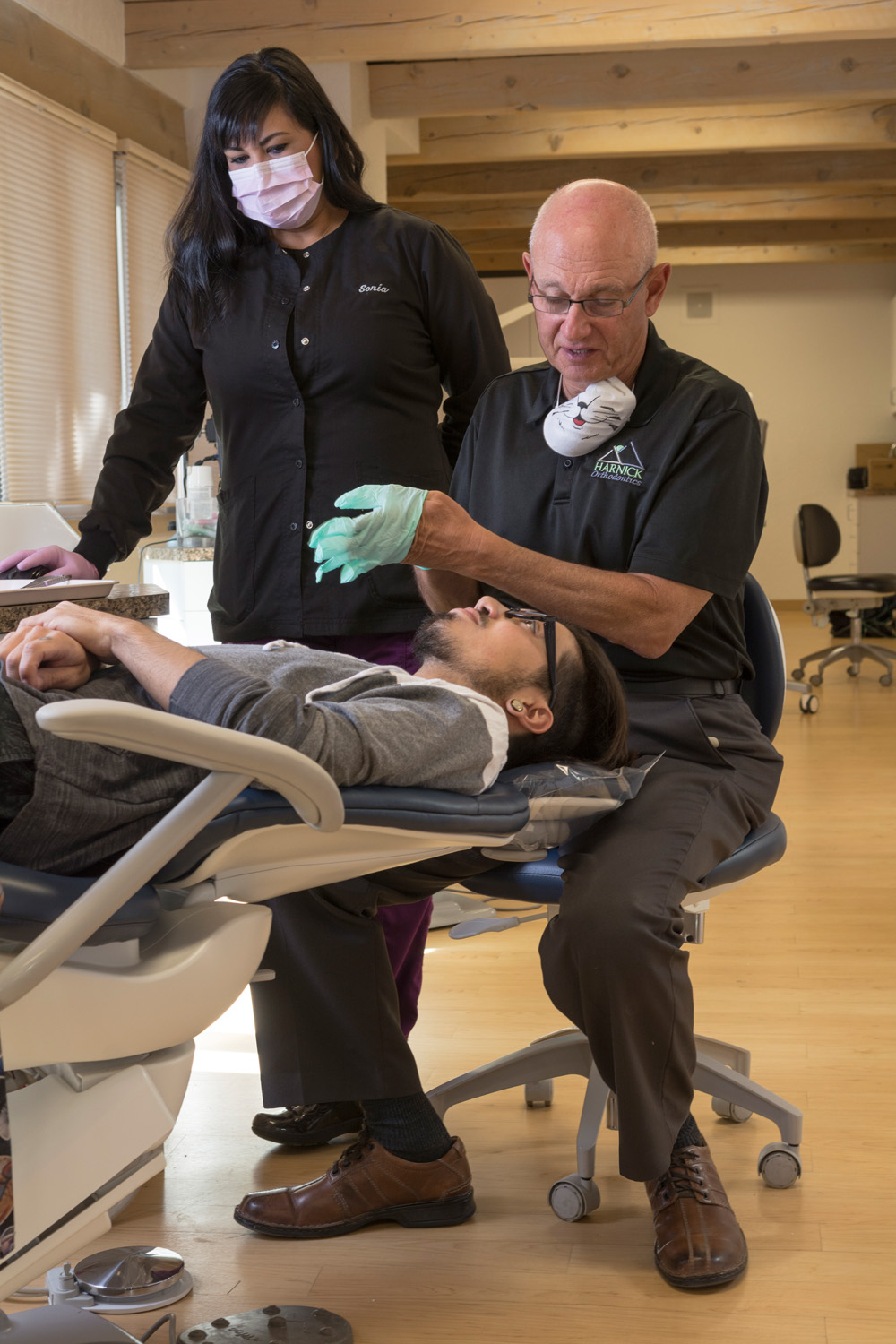 Dental assistant Sonia Martinez works with Dr. David Harnick as he examines a patient at Harnick Orthodontics in Albuquerque, New Mexico.