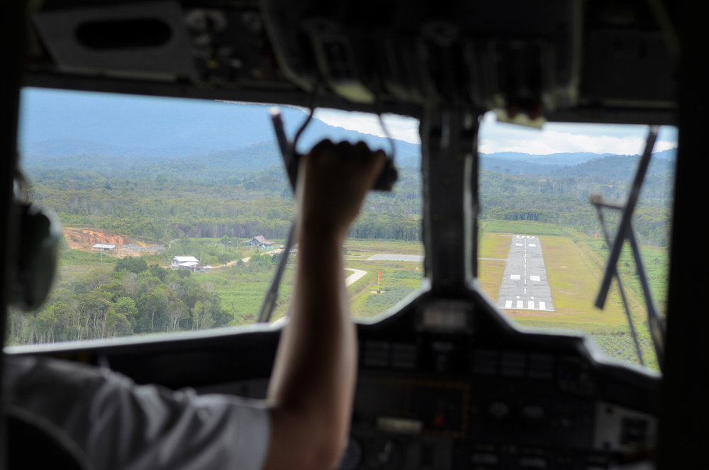 View through the windscreen of a DeHavilland Twin Otter on its final approach to the Bario Airport in the Kelabit Highlands of Sarawak, Malaysia.
