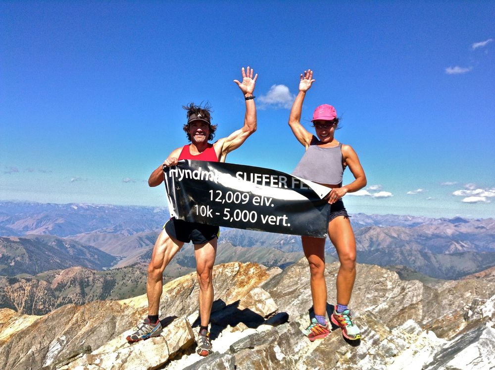 bill and naty on summit with banner.jpg