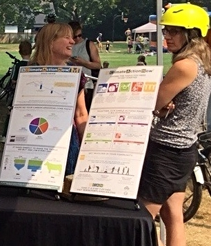 Annelise chatting with a biker about food waste with the new Portland CAN table at Sunday Parkways.