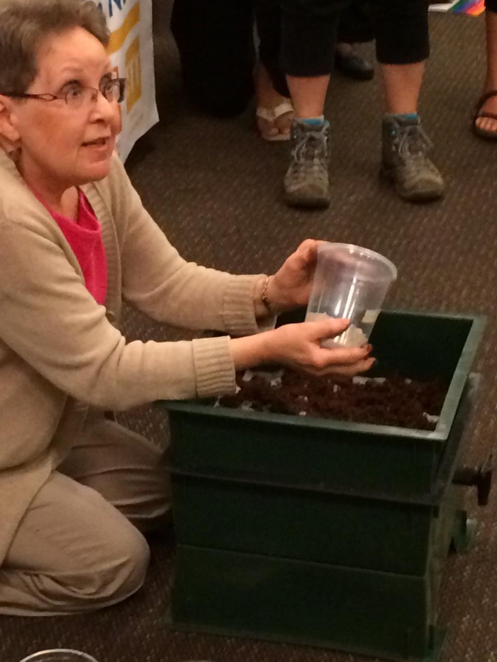 Kris LaMar gives a worm bin demonstration.