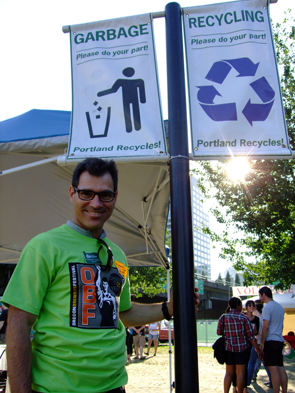 Francisco Gadea (Class 50) models fashionable recycling signs.