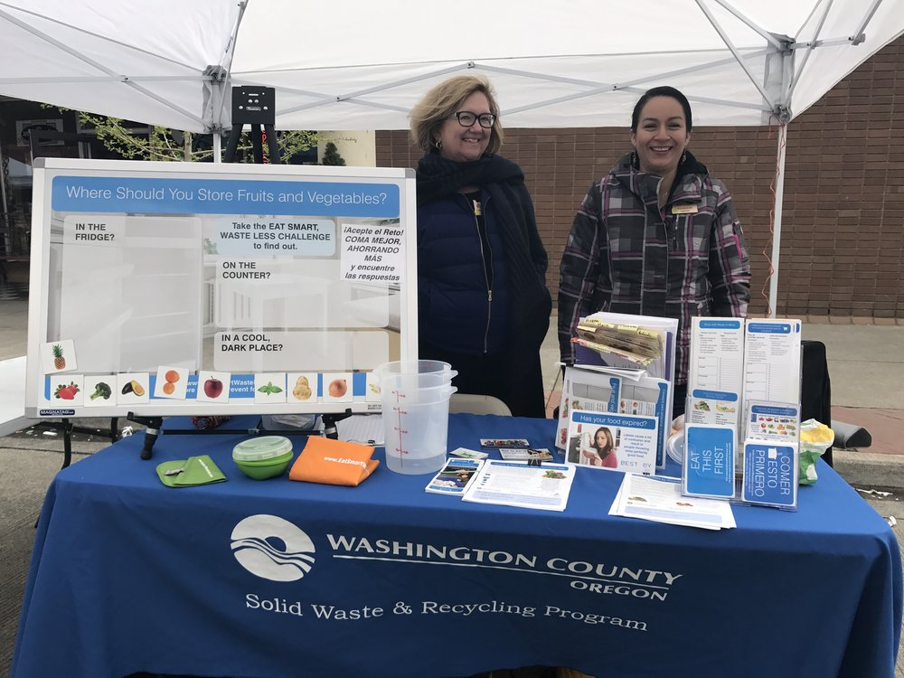Andrea and classmate Eva engage Latino Festival attendees with ideas to reduce food waste.