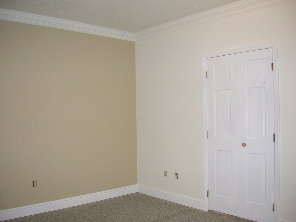 BEFORE. We designed a two-piece corner unit to match the style of the existing bedroom furniture.