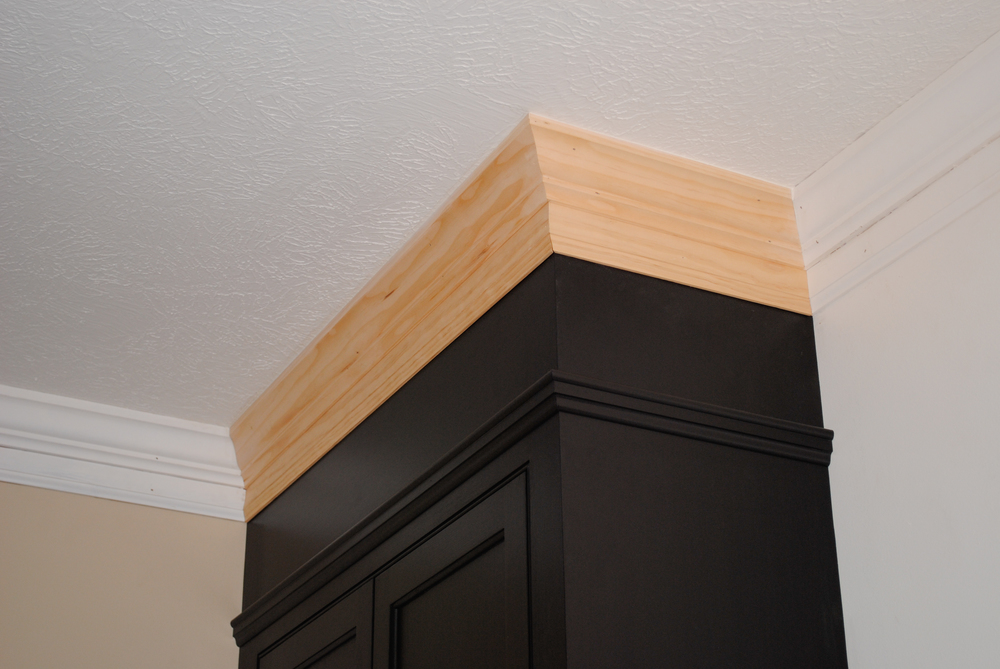 Two-piece crown. Cabinet doors are solid maple frame with maple ply panels.