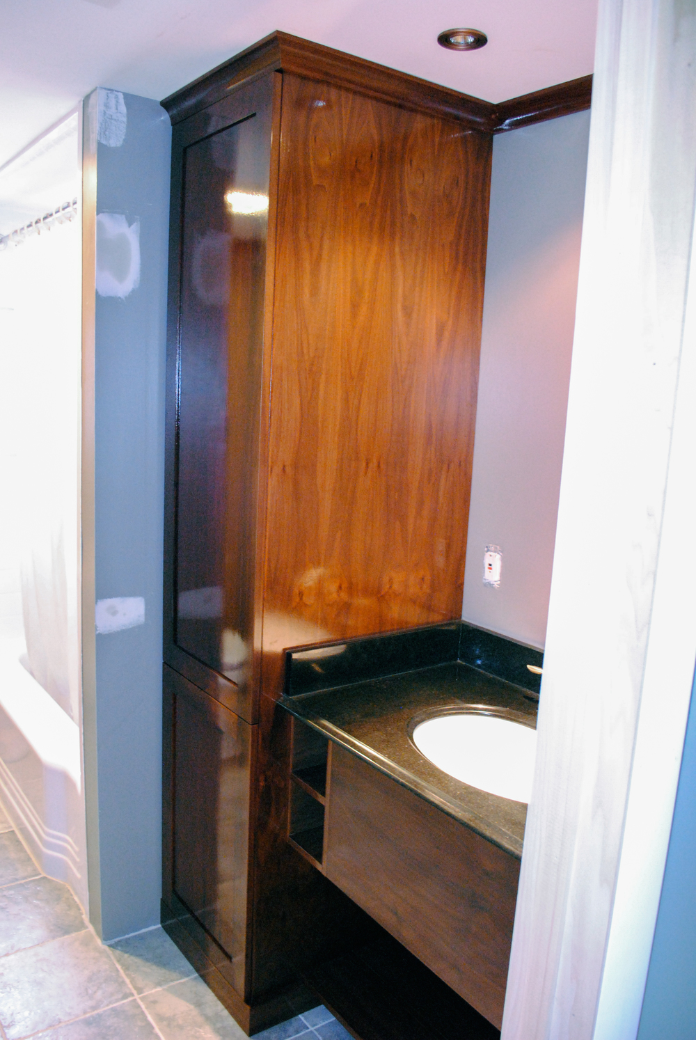 Custom cabinet, vanity, and trim in walnut veneer plywood.