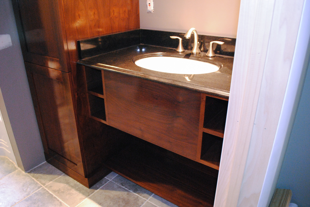 """Doors are solid stile & rail construction with 1/2"""" walnut ply panels. The counter was provided & installed by the homeowner."""