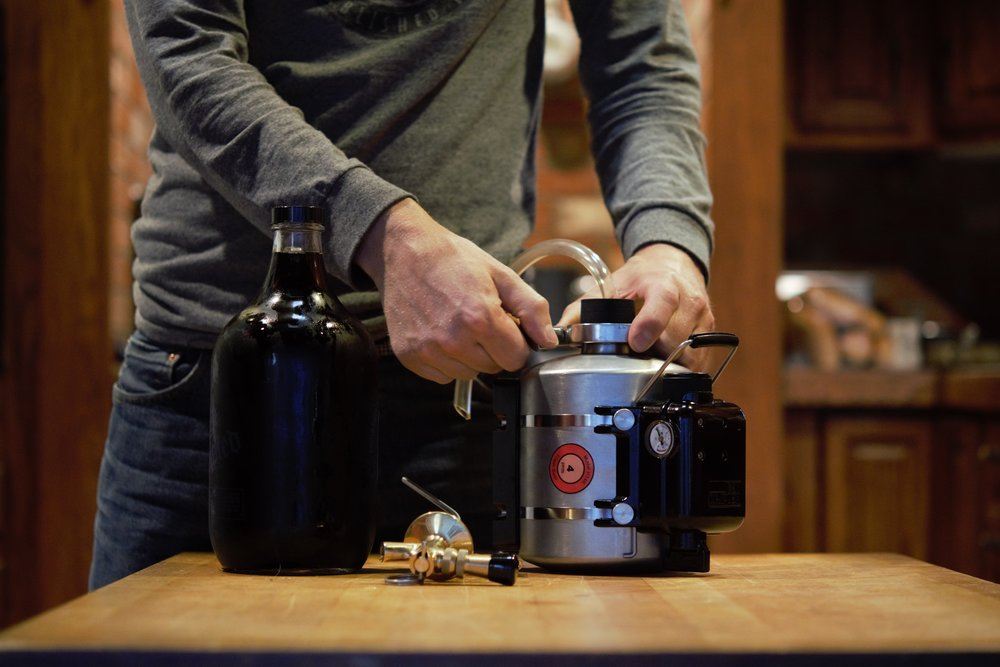 Transfer a glass growler in to the Hendrix mini keg