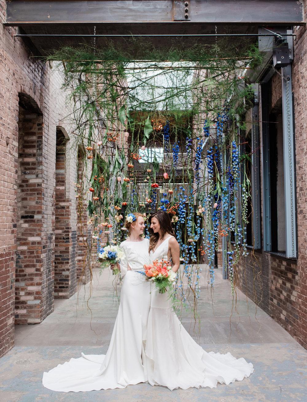 3-two-brides-flower-curtain-industrial-chic-mass-moca-wedding-hybl-fannin-design-1800cr.jpg