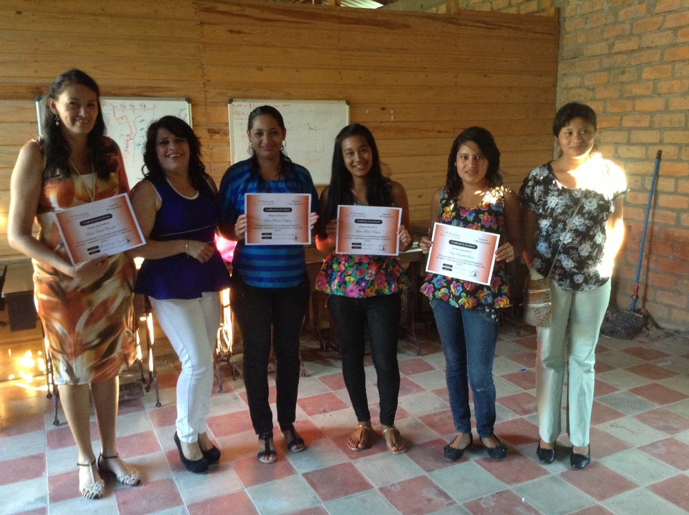 Nery 2014.  Receiving her sewing machine she was awarded for excellence in class.