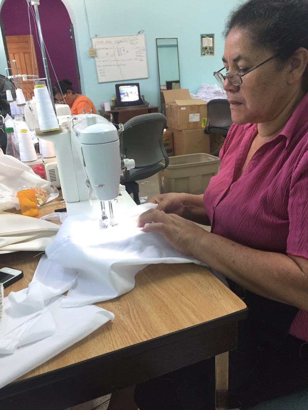 Saraita working on cubayeras (uniform shirts)2016