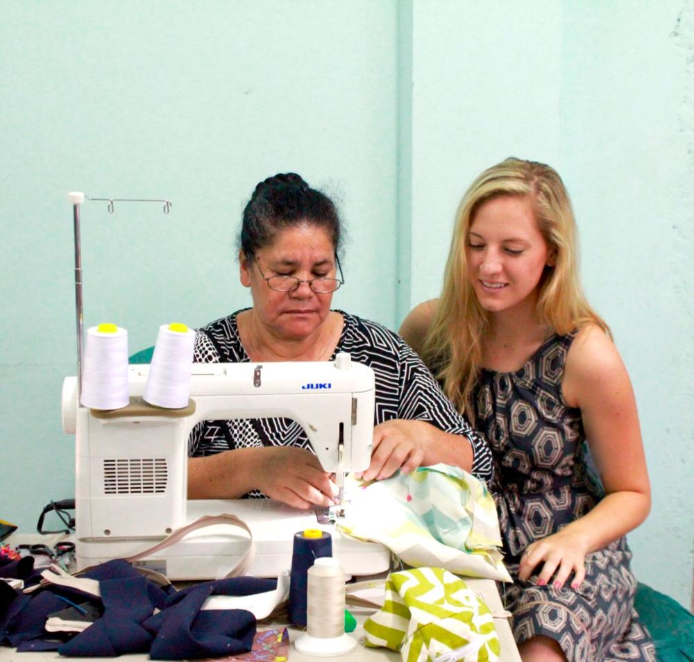 Alana working with Sara in the Mi Esperanza sewing maquila