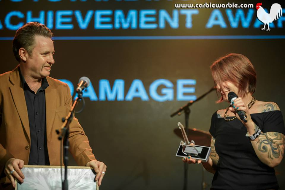 Music Victoria CEO Patrick Donovan presents Zo Damage with The Age Music Victoria Awards 2017  Outstanding Achievement Award  for her 365 Day Project and book  The Damage Report . [Photo: Carbie Warbie]