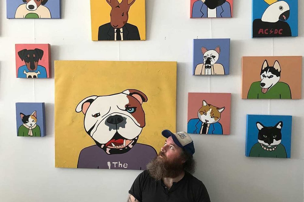 Joel Morrison with his Pet Portraits at the Zo Damage store.