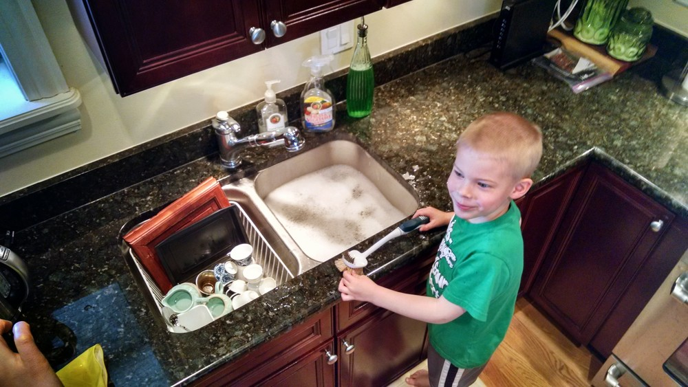 Ewan doing dishes.