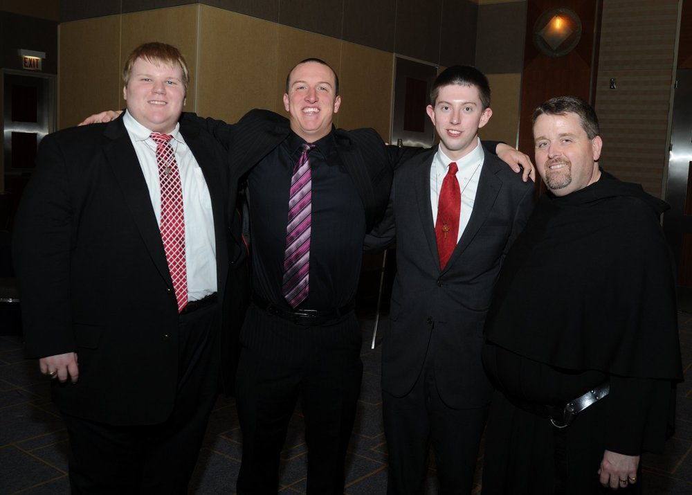 Fr. Tom McCarthy, O.S.A. (right) with three men currently in Augustinian formation and discernment