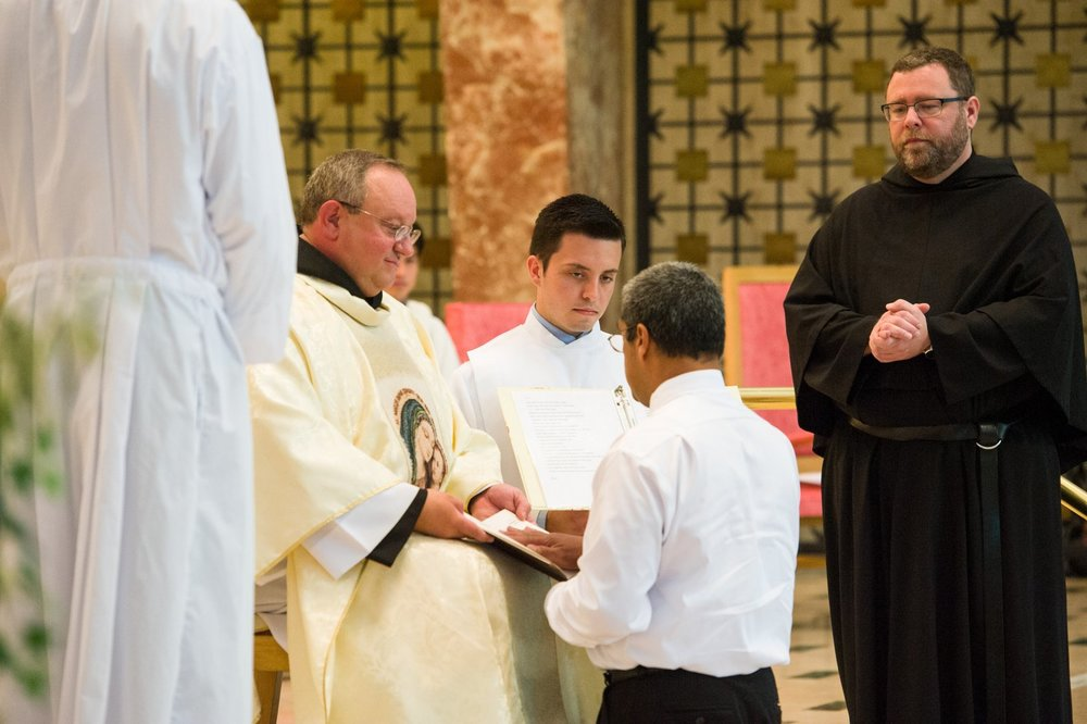 Fr. Joseph Broudou professes his first vows