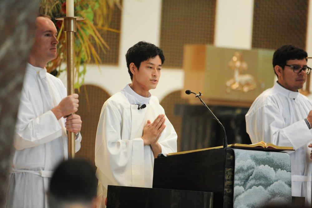 Deacon Futoshi Matsuo OSA reads the Gospel