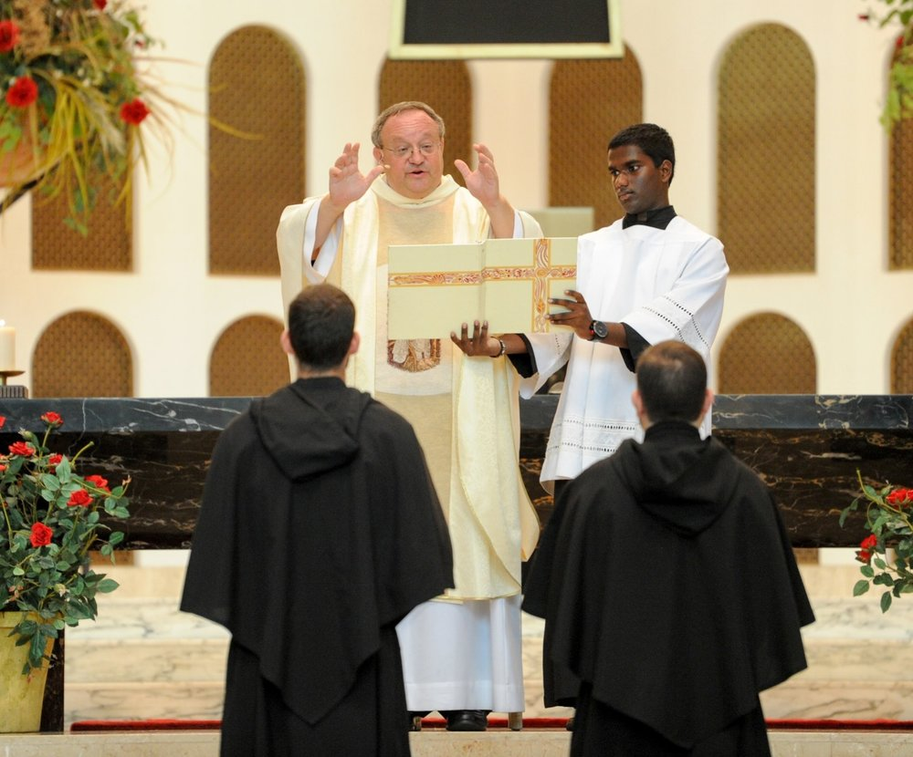 Even though one of these friars is called to ordained ministry and the other to lay religious life, both are seen here solemnly professing their perpetual vows together in the Augustinian Order