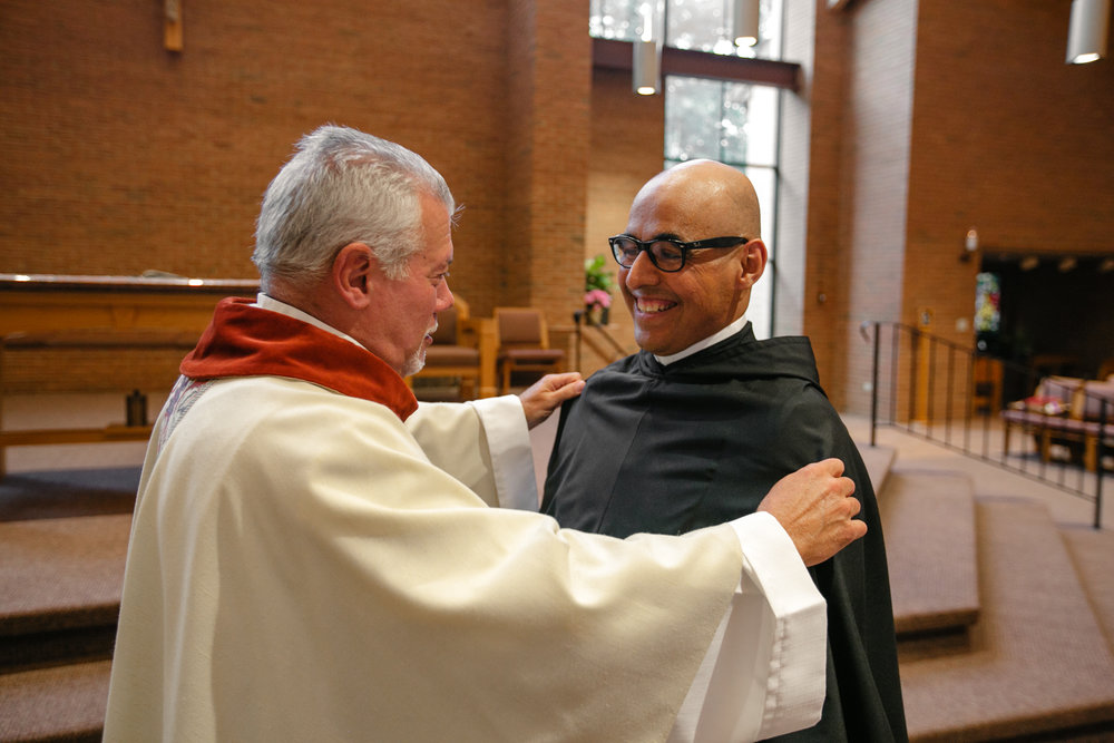Fr. Ray receives his habit from Prior Provincial Anthony Pizzo, OSA after his profession
