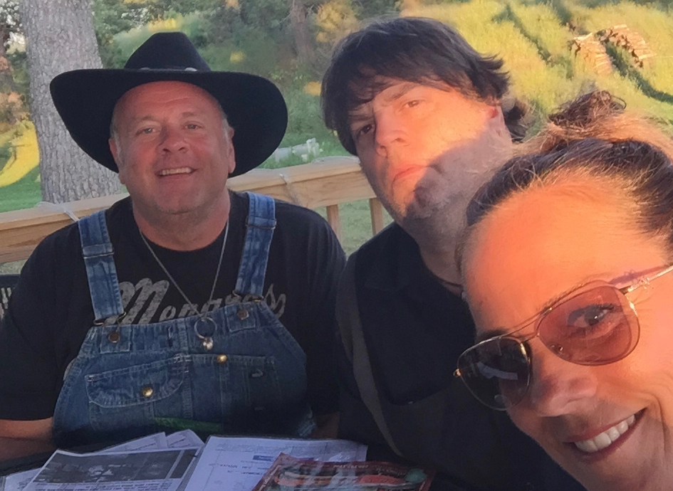 Brothers with their sister K.C. taking a break from the studio.