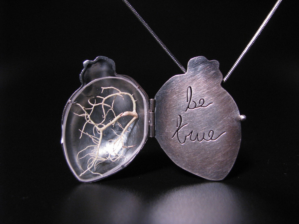 """""""Listen"""" 2007    This one was pretty special. I'd always wanted to make lockets, since working on the hinged heart piece from 2002. Thier storytelling capabilities, sentimentality, and ergonomics seemed to draw me in. I created my first locket- and anatomical heart with red birch branches which stated 'listen'. Taking an opportunity to show it at an art show, I slapped a high price tag on it, with the rationale of """"I don't want to sell it, this will be too expensive"""". While at the show, and old friend and art collector chatted to me about the meaning of the piece, where the ideas came from, and the emotion behind the piece. Half way through the conversation, he said """"I'll take it"""" (which is why I don't have a photo of the actual piece, this is a similar one which I made next). The story of the locket only starts there- he bought it as a last gift for his wife who was terminally ill with cancer, which touched me so, it almost brings me to tears. My journey of making jewelry with a true emotional connection had just begun..."""