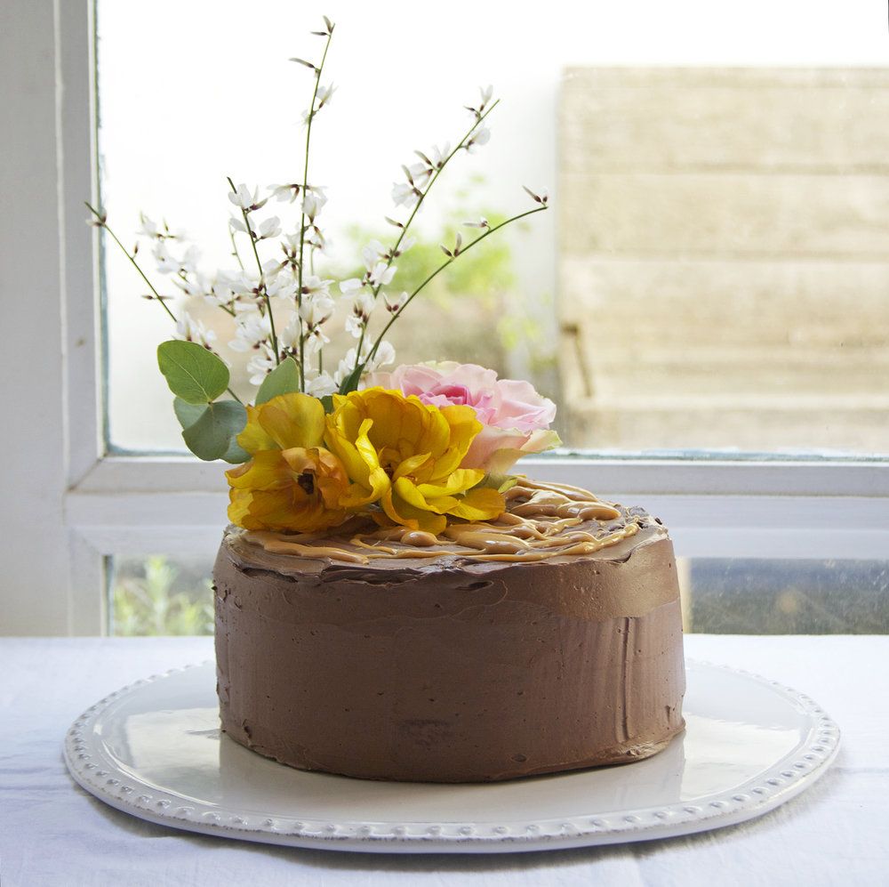 gluten free almond cake with chocolate fudge frosting and salted caramel