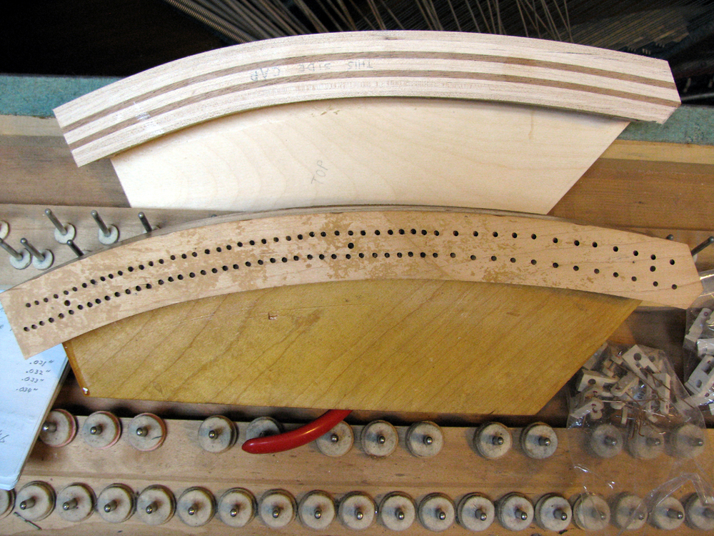 Here, Watson Piano Works has created a new, laminated bass bridge to replace an old, cracked bridge that had become unstable.