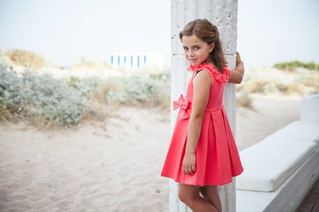 Coral dress available at El Rincon de Isabel, Spain. Delivers to U.S