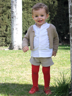 Boy wearing red ribbed tights under shorts.